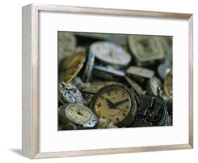 Old Watch Faces in Sand-Joel Sartore-Framed Photographic Print