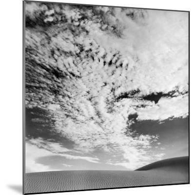 Cloud Covered Open Sky over Desert Landscape-Andreas Feininger-Mounted Photographic Print