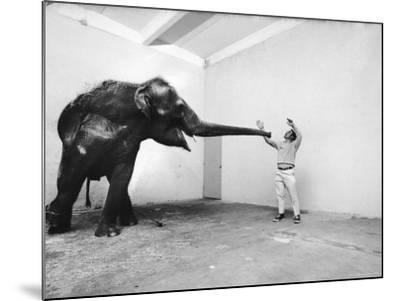 Life Photographer Arthur Schatz with Elephant While Shooting Story on the Franklin Park Zoo-Arthur Schatz-Mounted Photographic Print