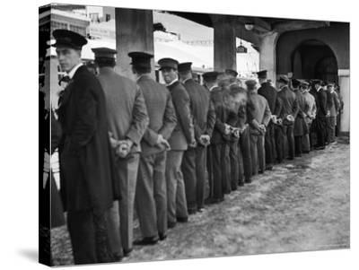 Hotel Porters Waiting For Zurich Arosa Train Arrival-Alfred Eisenstaedt-Stretched Canvas Print