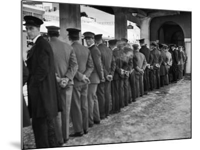 Hotel Porters Waiting For Zurich Arosa Train Arrival-Alfred Eisenstaedt-Mounted Photographic Print