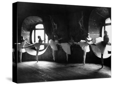 """Ballerinas at Barre Against Round Windows During Rehearsal For """"Swan Lake"""" at Grand Opera de Paris-Alfred Eisenstaedt-Stretched Canvas Print"""