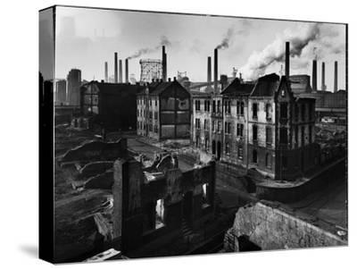 Bomb Damaged Buildings in the Shadow of the Thyssen Steel Mill-Ralph Crane-Stretched Canvas Print