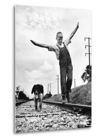 Larry Jim Holm with Dunk, His Spaniel Collie Mix, Walking Rail of Railroad Tracks in Rural Area-Myron Davis-Metal Print