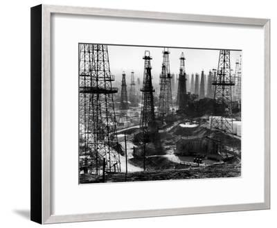 Forest of Wells, Rigs and Derricks Crowd the Signal Hill Oil Fields-Andreas Feininger-Framed Photographic Print