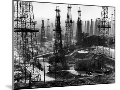 Forest of Wells, Rigs and Derricks Crowd the Signal Hill Oil Fields-Andreas Feininger-Mounted Photographic Print