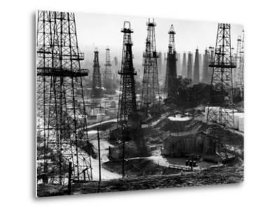 Forest of Wells, Rigs and Derricks Crowd the Signal Hill Oil Fields-Andreas Feininger-Metal Print