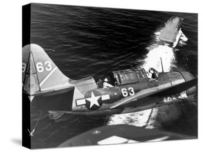 American SB2C Scout Plane Circling Above an Aircraft Carrier Prior to Landing--Stretched Canvas Print