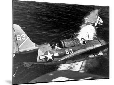 American SB2C Scout Plane Circling Above an Aircraft Carrier Prior to Landing--Mounted Photographic Print