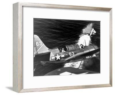 American SB2C Scout Plane Circling Above an Aircraft Carrier Prior to Landing--Framed Photographic Print