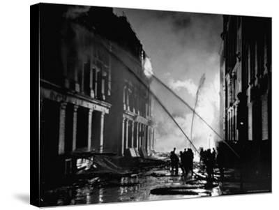 London Auxiliary Fire Service Working on a Fire Near Whitehall Caused by Incendiary Bomb-William Vandivert-Stretched Canvas Print