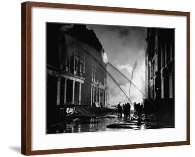 London Auxiliary Fire Service Working on a Fire Near Whitehall Caused by Incendiary Bomb-William Vandivert-Framed Photographic Print