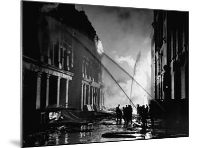London Auxiliary Fire Service Working on a Fire Near Whitehall Caused by Incendiary Bomb-William Vandivert-Mounted Photographic Print