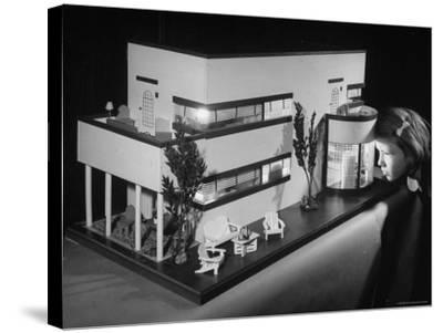 Little Girl Looking Into a Modern Doll House Being Sold at F.A.O. Schwarz-Herbert Gehr-Stretched Canvas Print