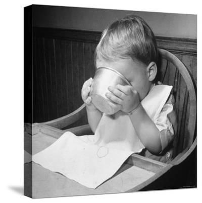 Fifteen Mo. Old Baby Demonstrates How He Can Now Drink from a Cup Even Though It is a Bit Sloppy-Nina Leen-Stretched Canvas Print