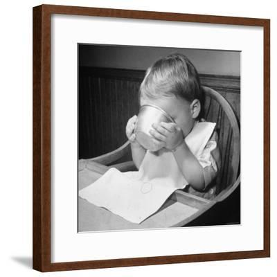 Fifteen Mo. Old Baby Demonstrates How He Can Now Drink from a Cup Even Though It is a Bit Sloppy-Nina Leen-Framed Photographic Print