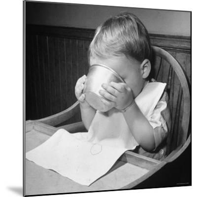 Fifteen Mo. Old Baby Demonstrates How He Can Now Drink from a Cup Even Though It is a Bit Sloppy-Nina Leen-Mounted Photographic Print