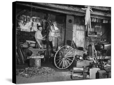 Blacksmith Working in His Shop-John Phillips-Stretched Canvas Print