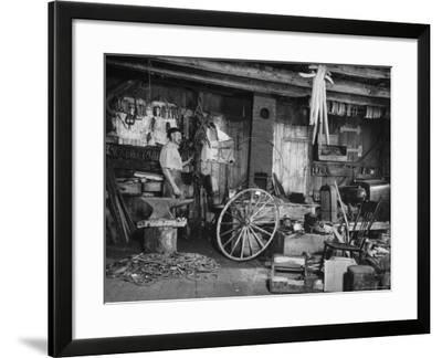 Blacksmith Working in His Shop-John Phillips-Framed Photographic Print