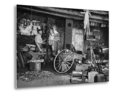Blacksmith Working in His Shop-John Phillips-Metal Print