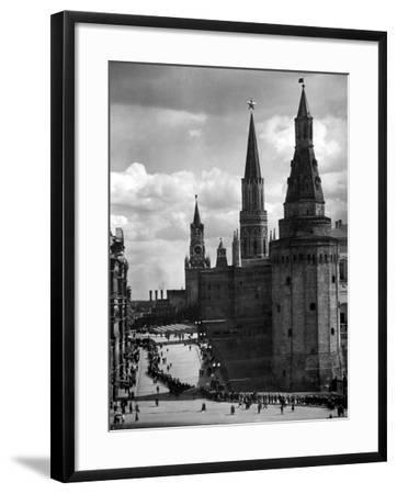 Line of Russians Along Street in Front of the Kremlin-Margaret Bourke-White-Framed Photographic Print