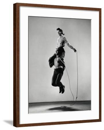 Jane Eakin on Shoulders of Rope Skipping Champion Gordon Hathaway-Gjon Mili-Framed Photographic Print