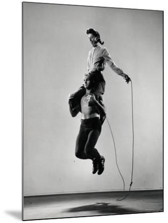 Jane Eakin on Shoulders of Rope Skipping Champion Gordon Hathaway-Gjon Mili-Mounted Photographic Print