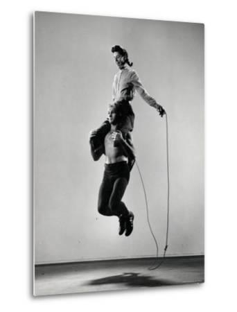 Jane Eakin on Shoulders of Rope Skipping Champion Gordon Hathaway-Gjon Mili-Metal Print