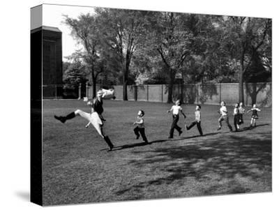 Uniformed Drum Major For University of Michigan Marching Band Practicing His High Kicking Prance-Alfred Eisenstaedt-Stretched Canvas Print
