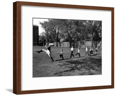 Uniformed Drum Major For University of Michigan Marching Band Practicing His High Kicking Prance-Alfred Eisenstaedt-Framed Photographic Print