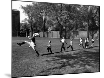 Uniformed Drum Major For University of Michigan Marching Band Practicing His High Kicking Prance-Alfred Eisenstaedt-Mounted Photographic Print