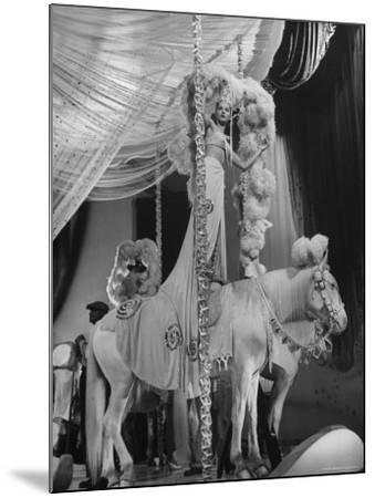 """Chorus Girl Standing on Horse's Back During Filming of the Movie """"The Ziegfeld Follies""""-John Florea-Mounted Photographic Print"""