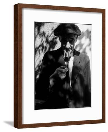 Farmer Who Has Brought His Grapes to the Hennessy and Co. Distillery Sampling Some Brandy-Gjon Mili-Framed Photographic Print