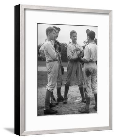 Boys Having a Discussion Before Playing Baseball-Nina Leen-Framed Photographic Print