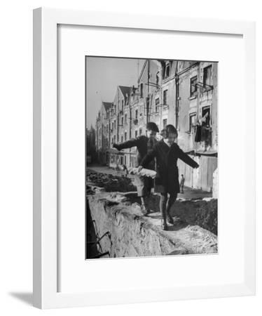 Children Playing-Nat Farbman-Framed Photographic Print