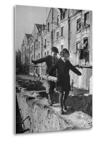 Children Playing-Nat Farbman-Metal Print