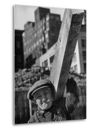 Construction Worker Carrying a Piece of Wood-Cornell Capa-Metal Print