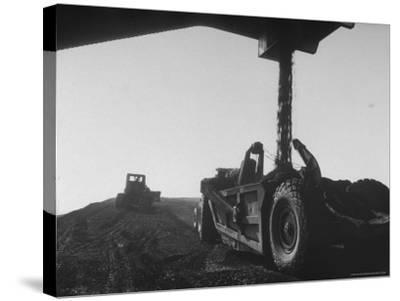 Coal Pile at World's Largest Coal Fueled Steam Plant under Construction by the TVA-Margaret Bourke-White-Stretched Canvas Print