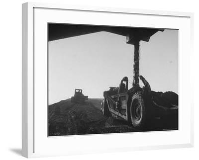 Coal Pile at World's Largest Coal Fueled Steam Plant under Construction by the TVA-Margaret Bourke-White-Framed Photographic Print