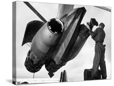 SAC's Maintenance Mechanic Sliding Into Barrel of Bomber's Jet Engine with the Help of His Partner-Margaret Bourke-White-Stretched Canvas Print