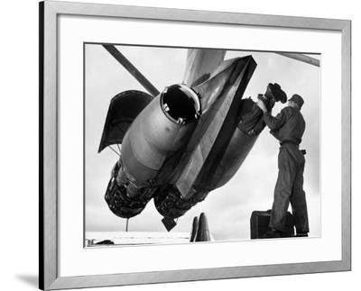 SAC's Maintenance Mechanic Sliding Into Barrel of Bomber's Jet Engine with the Help of His Partner-Margaret Bourke-White-Framed Photographic Print