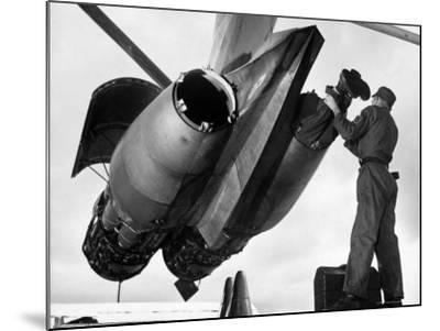 SAC's Maintenance Mechanic Sliding Into Barrel of Bomber's Jet Engine with the Help of His Partner-Margaret Bourke-White-Mounted Photographic Print