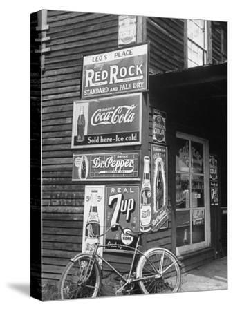 Food Store Called Leo's Place Covered with Beverage Ads Incl. Coca Cola, 7 Up, Dr. Pepper and Pepsi-Alfred Eisenstaedt-Stretched Canvas Print