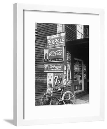 Food Store Called Leo's Place Covered with Beverage Ads Incl. Coca Cola, 7 Up, Dr. Pepper and Pepsi-Alfred Eisenstaedt-Framed Photographic Print