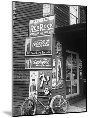 Food Store Called Leo's Place Covered with Beverage Ads Incl. Coca Cola, 7 Up, Dr. Pepper and Pepsi-Alfred Eisenstaedt-Mounted Photographic Print