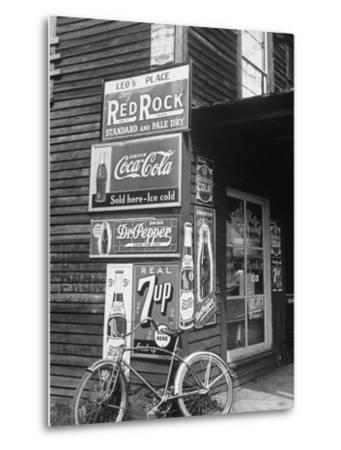 Food Store Called Leo's Place Covered with Beverage Ads Incl. Coca Cola, 7 Up, Dr. Pepper and Pepsi-Alfred Eisenstaedt-Metal Print