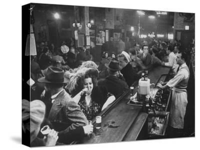 Bar Crammed with Patrons at Sammy's Bowery Follies-Alfred Eisenstaedt-Stretched Canvas Print
