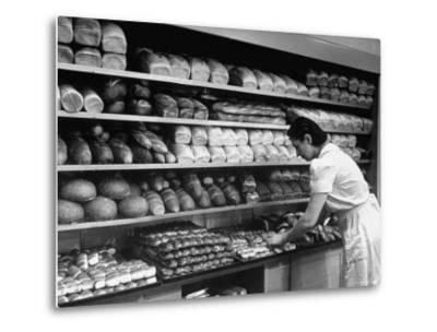 Good of Worker in Bakery Standing in Front of Shelves of Various Kinds of Breads and Rolls-Alfred Eisenstaedt-Metal Print