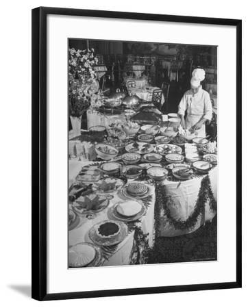 Chef Preparing Dish at Buffet Table in Dining Room of the Waldorf Astoria Hotel-Alfred Eisenstaedt-Framed Photographic Print