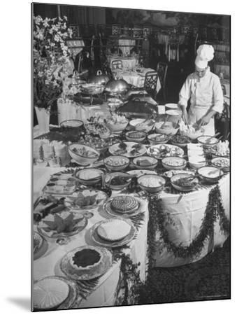 Chef Preparing Dish at Buffet Table in Dining Room of the Waldorf Astoria Hotel-Alfred Eisenstaedt-Mounted Photographic Print